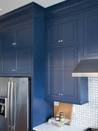 kitchen teal blue kitchen caibnet with black ceramic backsplash