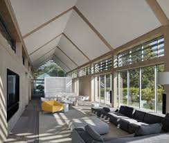 wood slat covered glass volumes create an elegant interior at this