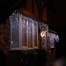 icicle christmas lights how to run christmas lights around a window festive lights