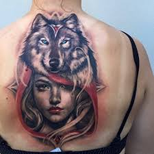 nice face with awesome wolf face tattoo on back