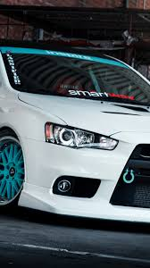 blue mitsubishi lancer white tuning mitsubishi lancer evo x with blue wheels wallpaper
