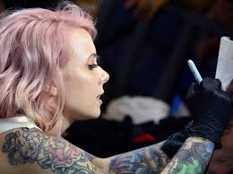 why we u0027re obsessed with tattoos according to a tattoo artist