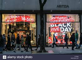 black friday sale stores aritzia store windows advertising black friday sales nyc stock