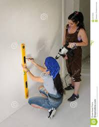 two women renovating a house royalty free stock photo image