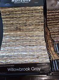 close up photo of woven shade master bedroom roman shade horizons