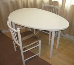 shaped dining table white egg shaped desk or dining table and two chairs unique pieces