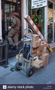 united parcel service delivering packages in nyc stock photo