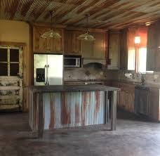 rustic kitchen with old door for pantry door custom made island