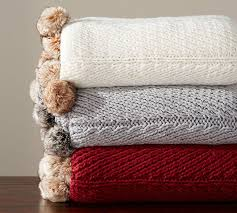 faux fur pom pom knitted throw pottery barn