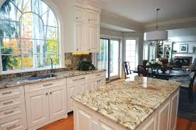painted vs stained kitchen cabinets painting vs staining kitchen cabinets faced
