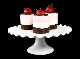 mini neapolitan mousse cakes garnished with fresh strawberries