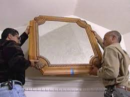 hanging picture how to hang a heavy mirror hgtv
