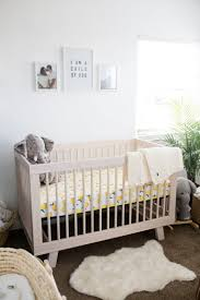 readers u0027 favorite modern boho nursery with a punch of tropics