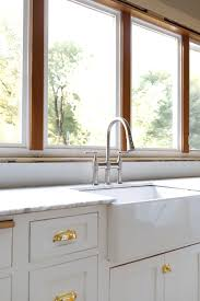 kitchen cabinet sink faucets farmhouse kitchen our new sink and faucet the grit and