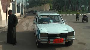 peugeot taxi taxi driver with peugeot 504 luxor egypt clip 7734727