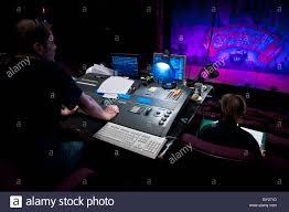a operating a digital lighting desk board in a theatre