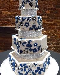 bridal cakes 4 tier cake rhinestones and blue applique flower unforgettable