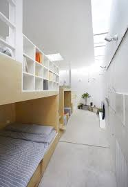 l shaped house composed of wooden boxes b l u e architecture