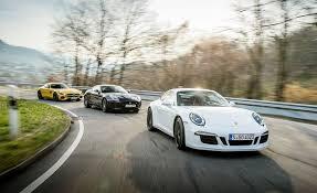 jaguar f type vs porsche 911 2016 jaguar f type r coupe 2015 porsche 911 gts and 2016
