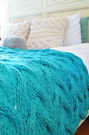 light turquoise chunky cable knit blanket in cream irish wool