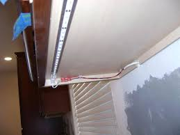 install under cabinet lighting led light strip installation and tape daisy chain strips install