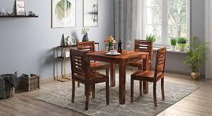 dining table set with storage arabia capra 4 seater storage dining table set urban ladder