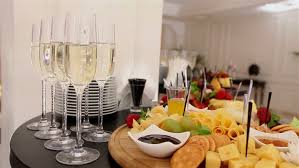 Restaurant Buffet Table by Glasses Of Champagne And Wine On The Buffet Table A Bottle Of