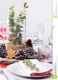 rustic christmas centerpiece for dinner place setting stock photo