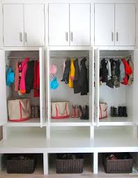 mudroom cubbies with usb charging station in a laundry room