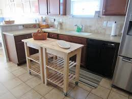 gray solid wood kitchen island with brown walnut wood breakfast