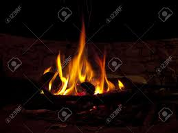 warming fireplace in winter at home close up of flames and