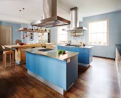 11 kitchen island design ideas period living the new brasserie kitchen from smallbone can incorporate double island layouts shown with a bold blue paint finish from 40 000 for a kitchen