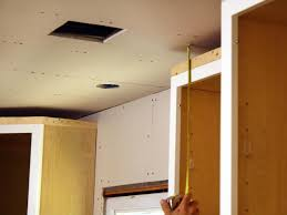 how to install light under kitchen cabinets how to install kitchen cabinet crown molding how tos diy
