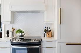 All White Kitchen With Herringbone Backsplash Transitional Kitchen - Herringbone tile backsplash