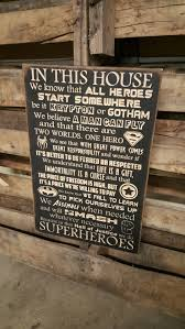 custom carved wooden sign superheroes in this by hayleescloset