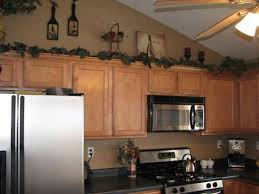 Kitchen Decorations For Above Cabinets Wine Theme Kitchen Ideas With Wine Bottles Above Cabinets