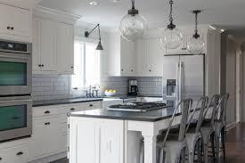 black and white kitchen with tolix marais counter stools