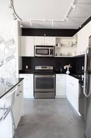 kitchen white cabinets black appliances kitchen tiles design