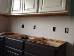 how to paint unfinished cabinets should the underside of white painted semi custom