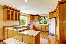what to do with brown kitchen cabinets light brown kitchen cabinets white appliances and hardwood floor stock photo image now