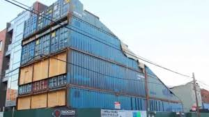 unusual wedge shaped shipping container townhouse rises in