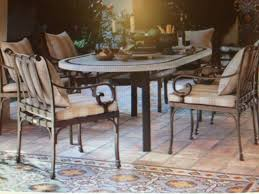 charleston gazette mail wv design team outdoor entertaining options a covered dining area is in a new design called toscano by brown jordan it has an italian influence set on a tile surface with flowing lines and scrolling