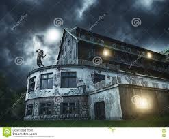 scary zombie on a balcony of the spooky house stock photo