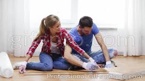 building and home concept smiling measuring wood flooring