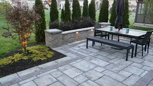 landscaping adds privacy to custom paver patio landscaping