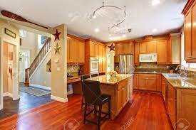 open floor plan view of elegant kitchen area with kitchen island
