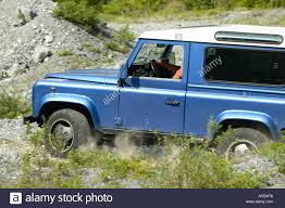 white land rover defender 90 land rover defender 90 td5 station wagon blue metallic with white