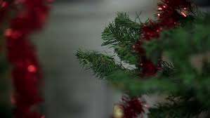 red ribbon christmas tree decorating in close up stock footage