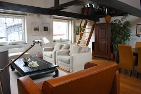 caramel leather sofa living room eclectic with none