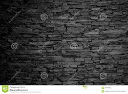 charcoal stone wall background texture black and white stock photo